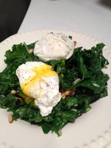 raw kale salad with poached eggs